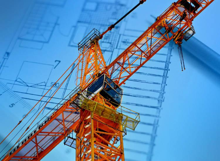 A construction crane in an engineer plan background